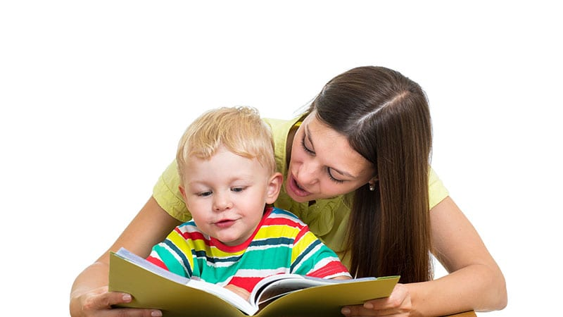 mom and son reading a book together
