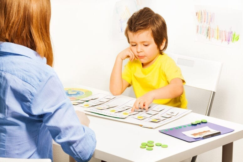 Boy in ABA therapy session