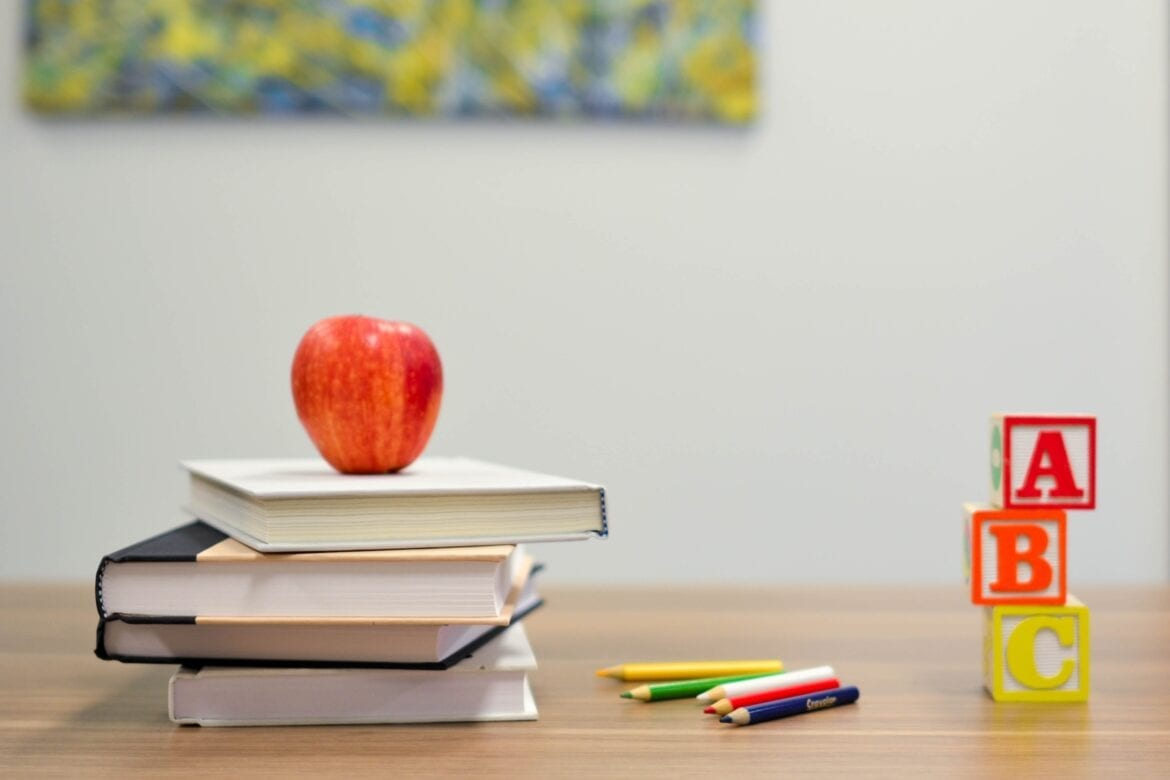 Desk with books and apple